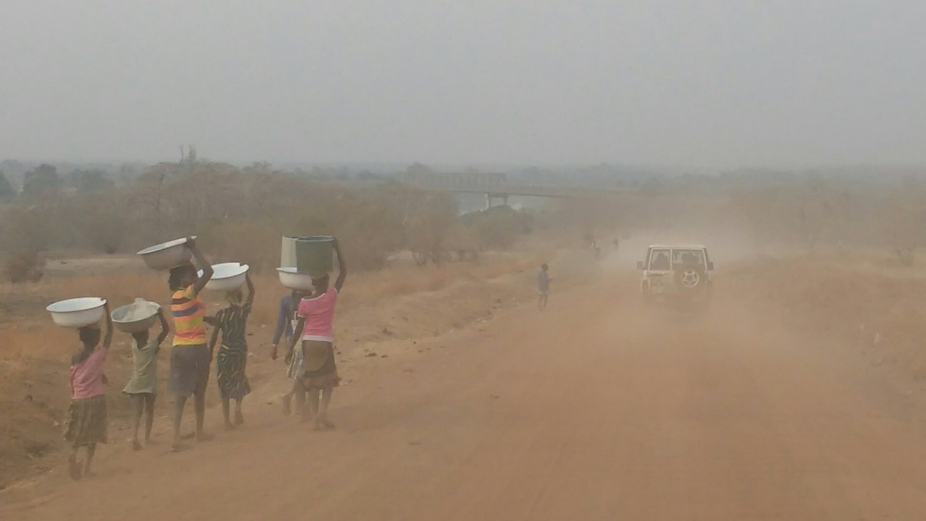 Girls in northern Ghana walking to the river for water during the dusty dry season.