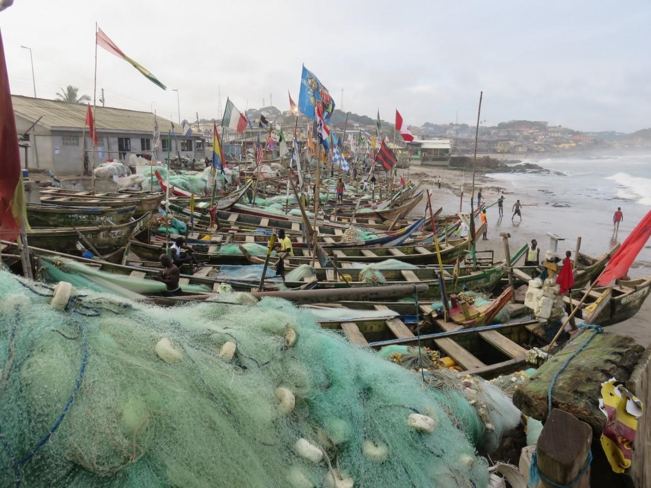 Fishermen mending their nets in the seaside town of Cape Coast, Ghana.