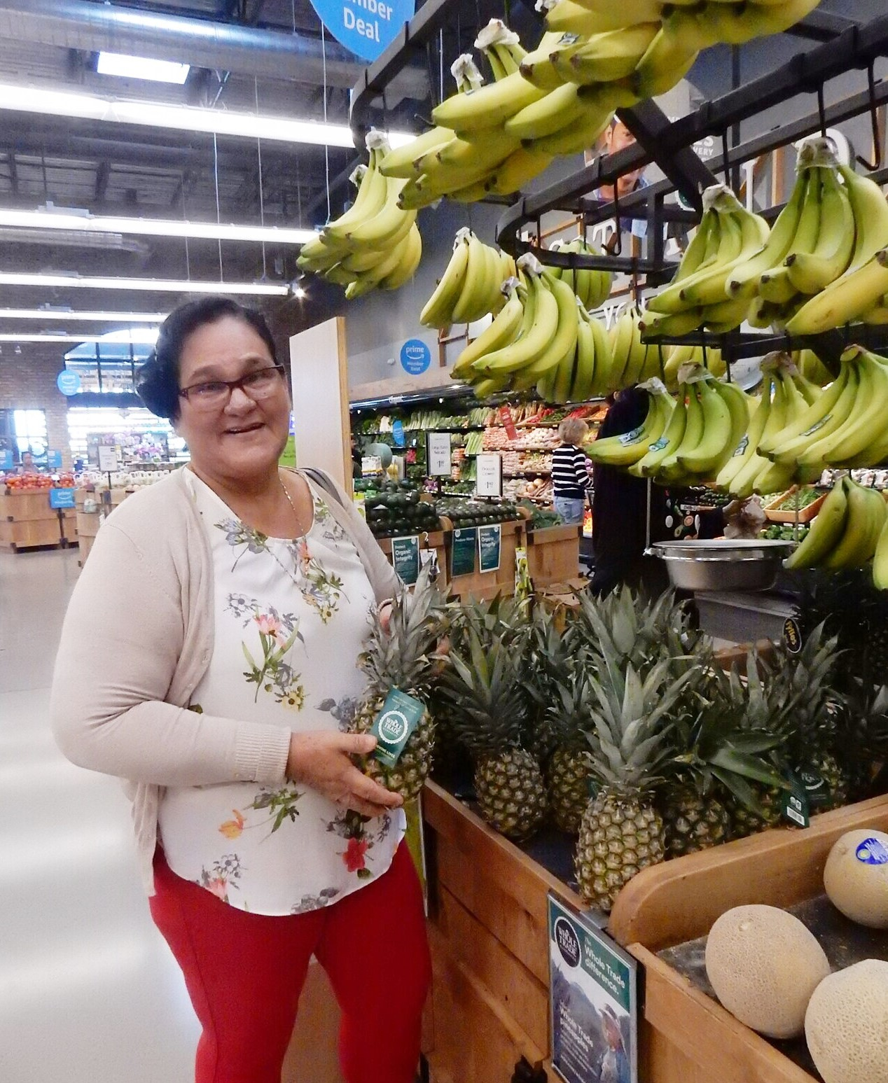 Erlinda checks out pineapples in a supermarket in New York.