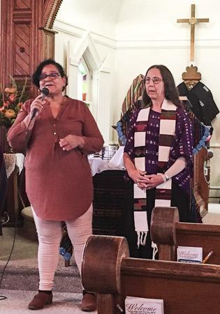 Erlinda speaking and Karla interpreting in Ocean View, Delaware.