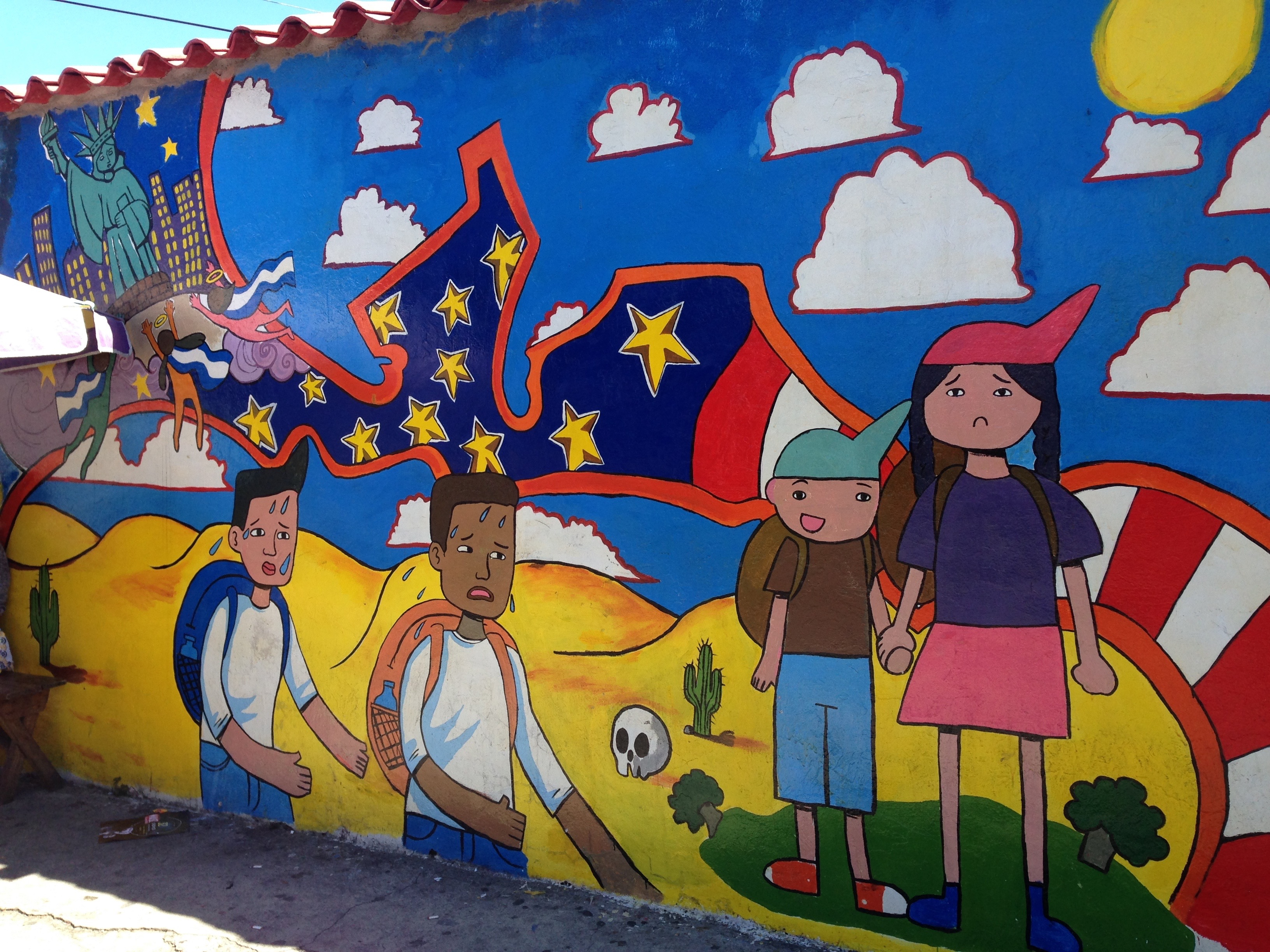 Migration-themed mural outside the city hall of Soyopango, El Salvador