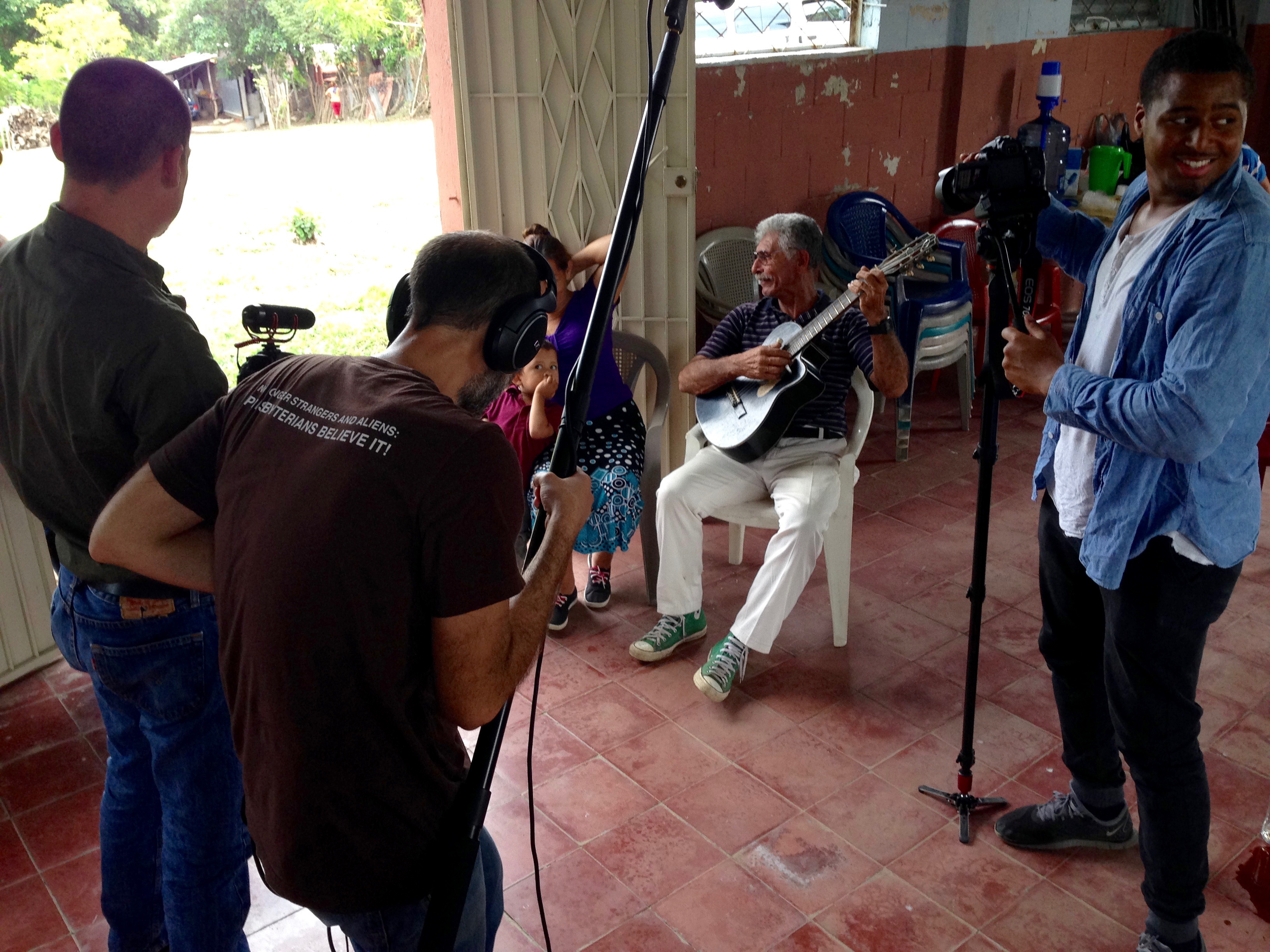 Videography team capturing a local musician