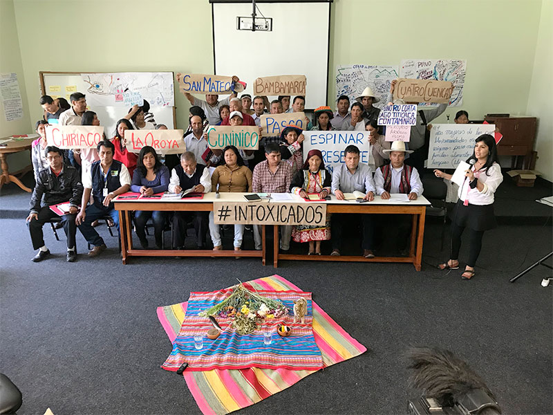 Leaders from nine communities impacted by mining contamination gathered for a press conference calling for a National Strategy for Human and Environmental Health. On the floor in front of them is an offering expressing gratitude to God for the gift of the Earth.