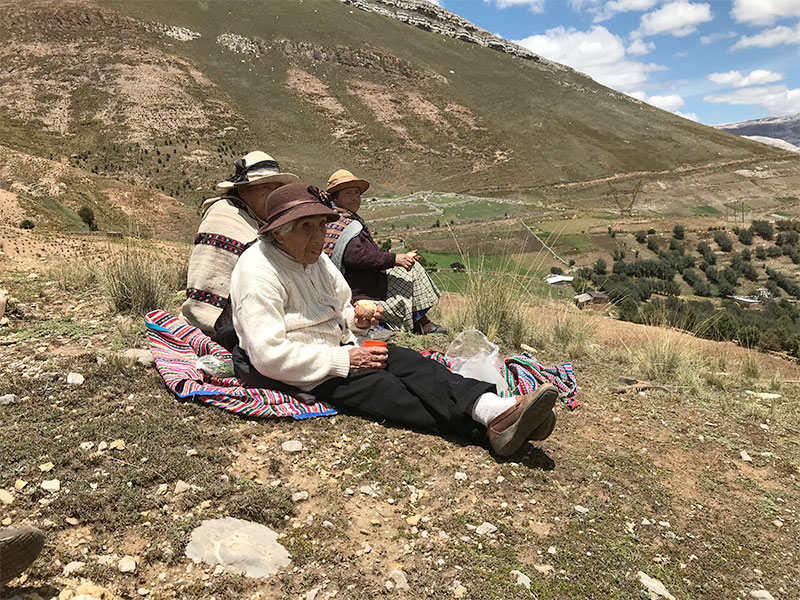 On the outskirts of La Oroya — one of the most contaminated cities in the world due to mining-related activity — community members take a rest from their efforts of reforestation and remediation of their community land.