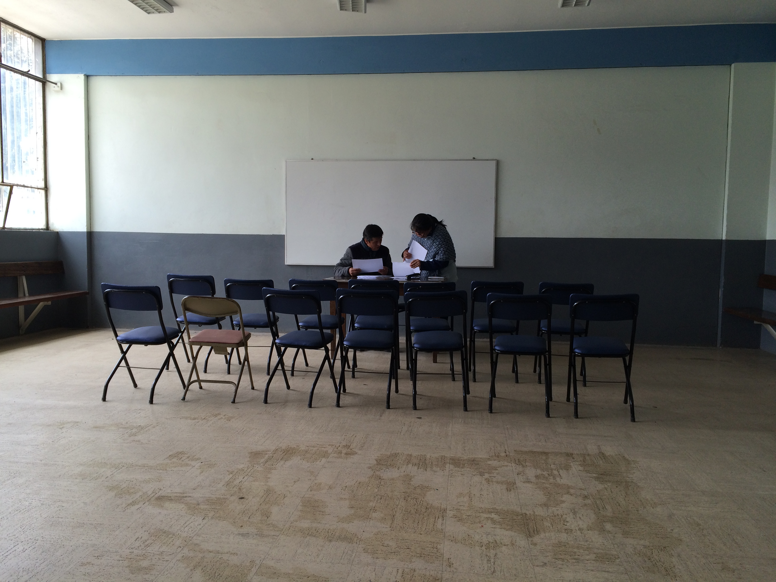 Our partners prepare the necessary legal paperwork as they wait at the local parish in La Oroya to execute the health study.