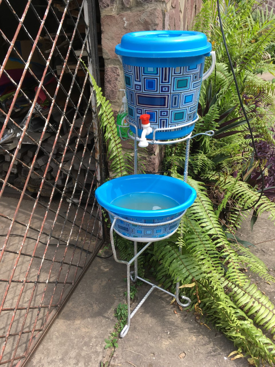 A deluxe hand-washing station with matching bucket & basin. Hand-washing stations are being purchased for 1055 health facilities. (Photo: Cindy Dunn)
