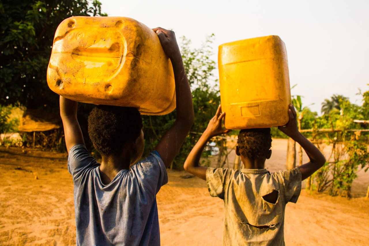 In rural areas of Congo, many children haul water every day from the spring for household use and washing hands. Lack of running water makes good hygiene practices like washing hands challenging to adhere to. (Photo: Crystal Stafford)