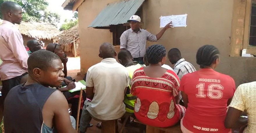 A CEUM community animator meets with community health volunteers to map out screening of children in their community.