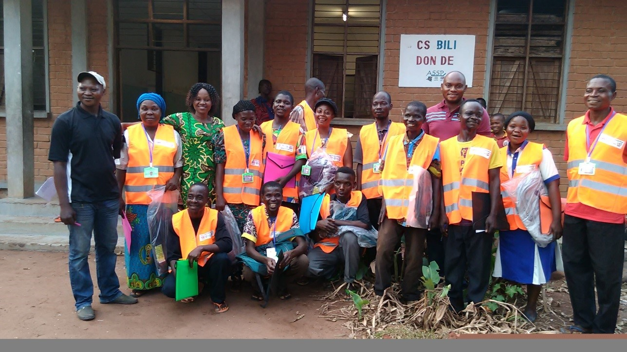 A happy group of community health volunteers at Bili Health Center sporting the orange vests they just received through the ASSR project to increase their visibility in the community.
