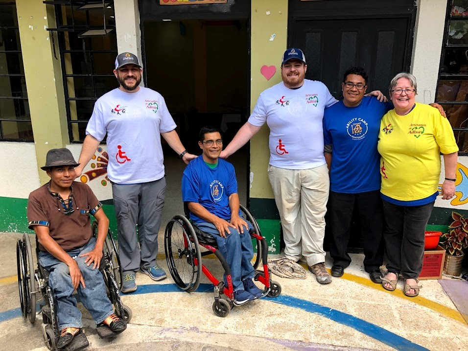 Salvador Mendoza, José Sosof, and Pedro Sisay (Special Education School principal), gift Basil Lyberg and Spencer Haworth (The Ability Experience leaders) and Leslie Vogel (CEDEPCA facilitator/interpreter) with screen print t-shirts from the Artisan group and the school.