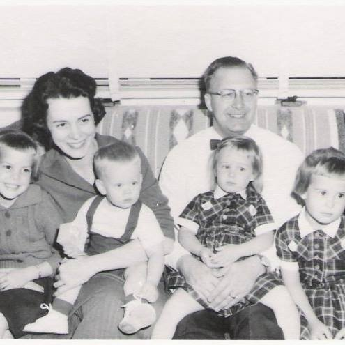 My mission worker parents with their children in Ganado, Arizona. I am sitting in my father's lap.