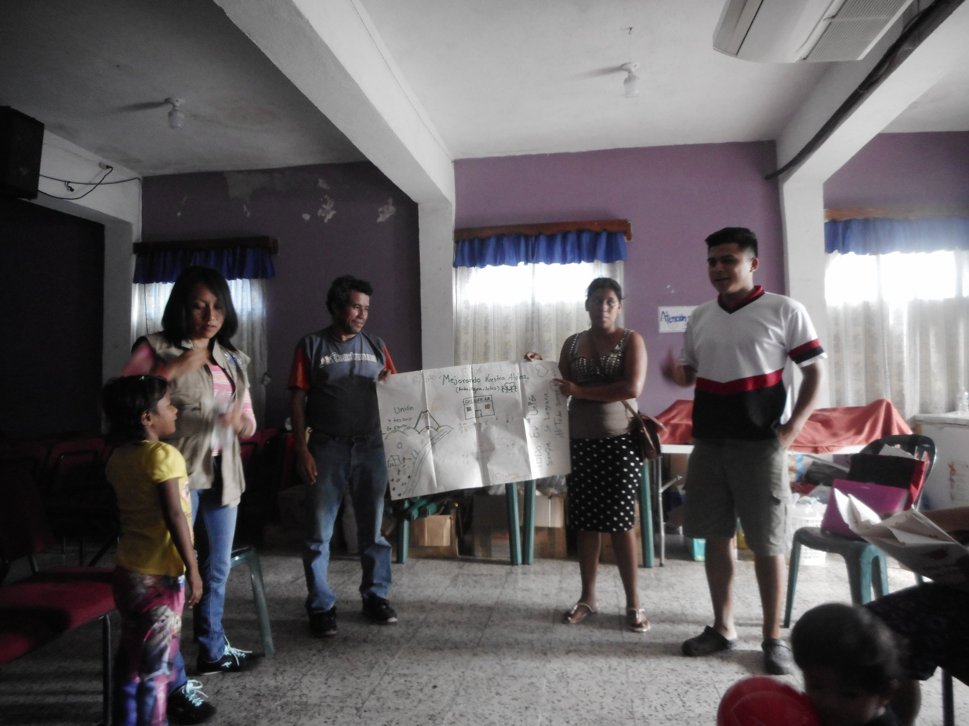"""Survivors of the volcanic eruption participate in a """"mapping"""" exercise to improve communications and services in their community as part of CEDEPCA's psychosocial work."""