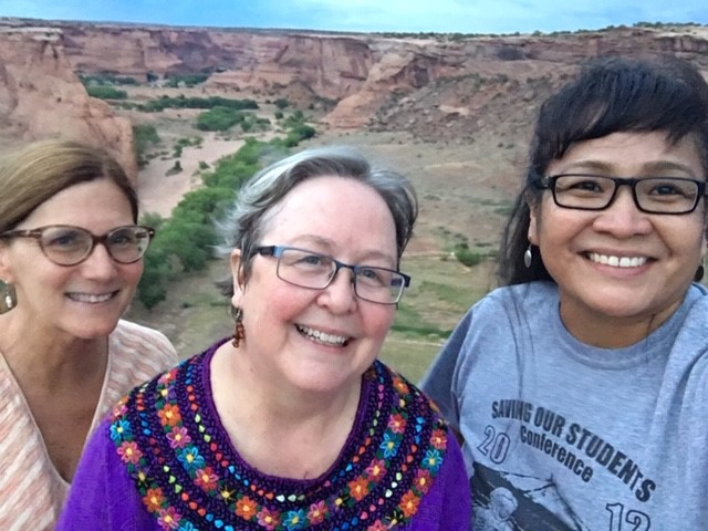 At Canyon de Chelly in the Navajo Nation, with pastor Ann Conklin (First PC Mesa, AZ) and ruling elder Kathy Mitchell (Trinity PC, Chinle, AZ) — part of a shared summer mission experience between a white urban (FPC Mesa) and a rural Navajo congregation (Tseyii Bidaa Presbyterian Church).