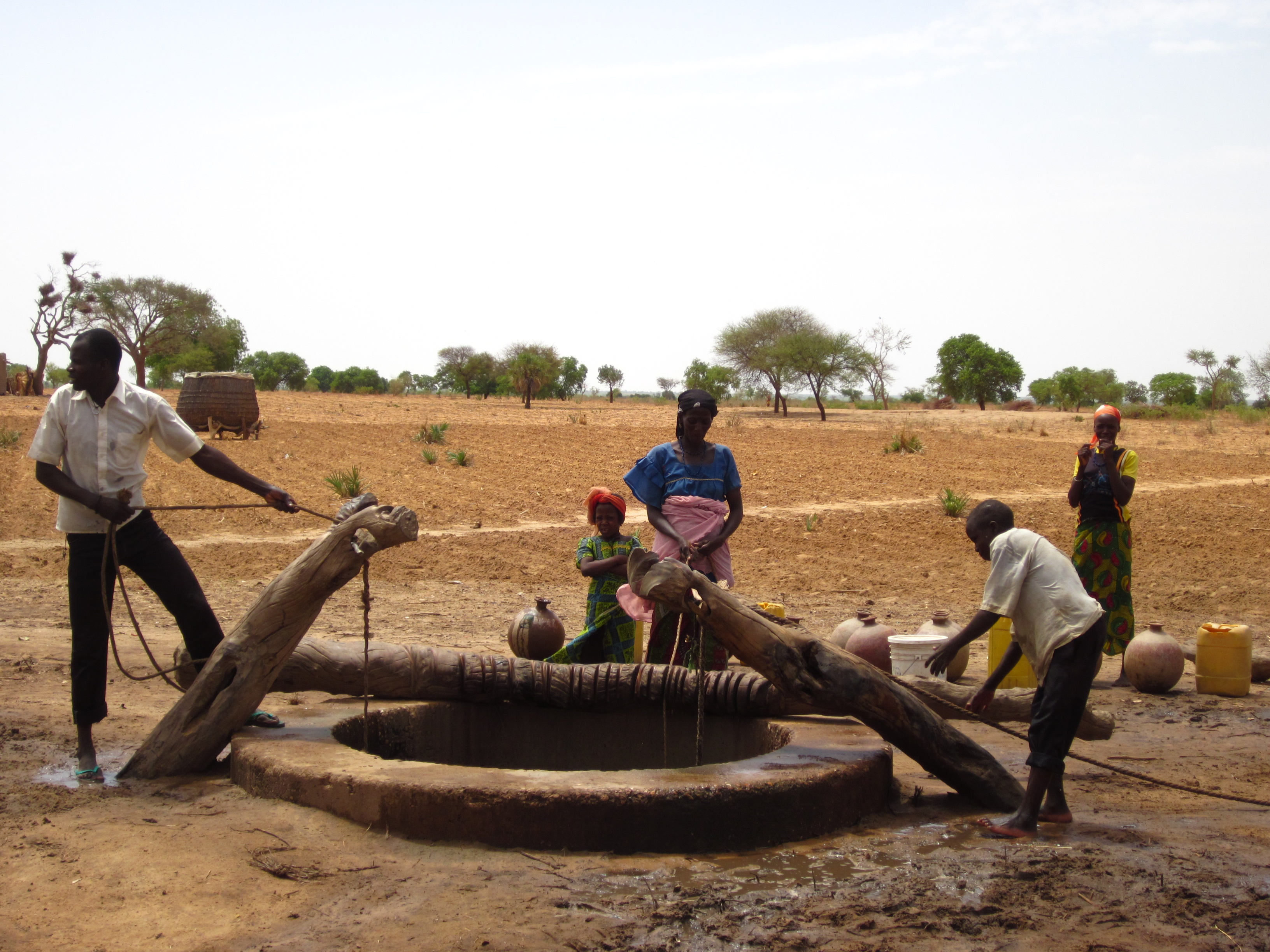A typical village well that can often get filled in through wind and rain. (photo: Josh Heikkila)