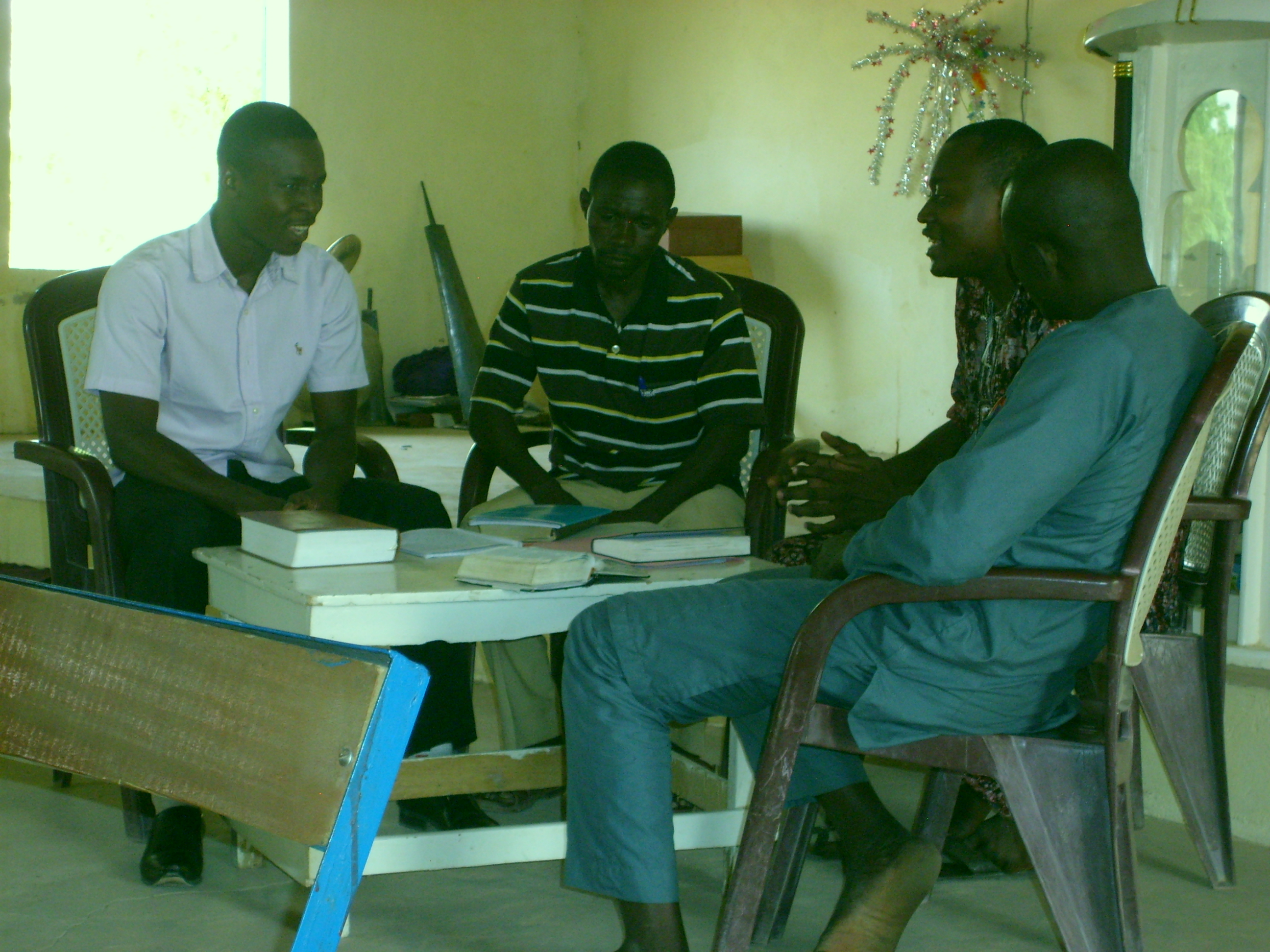 Himma (center) at our training, in group practice of 3x3 discussion with follow-up of actions from last week, a new lesson, and planning new action steps.