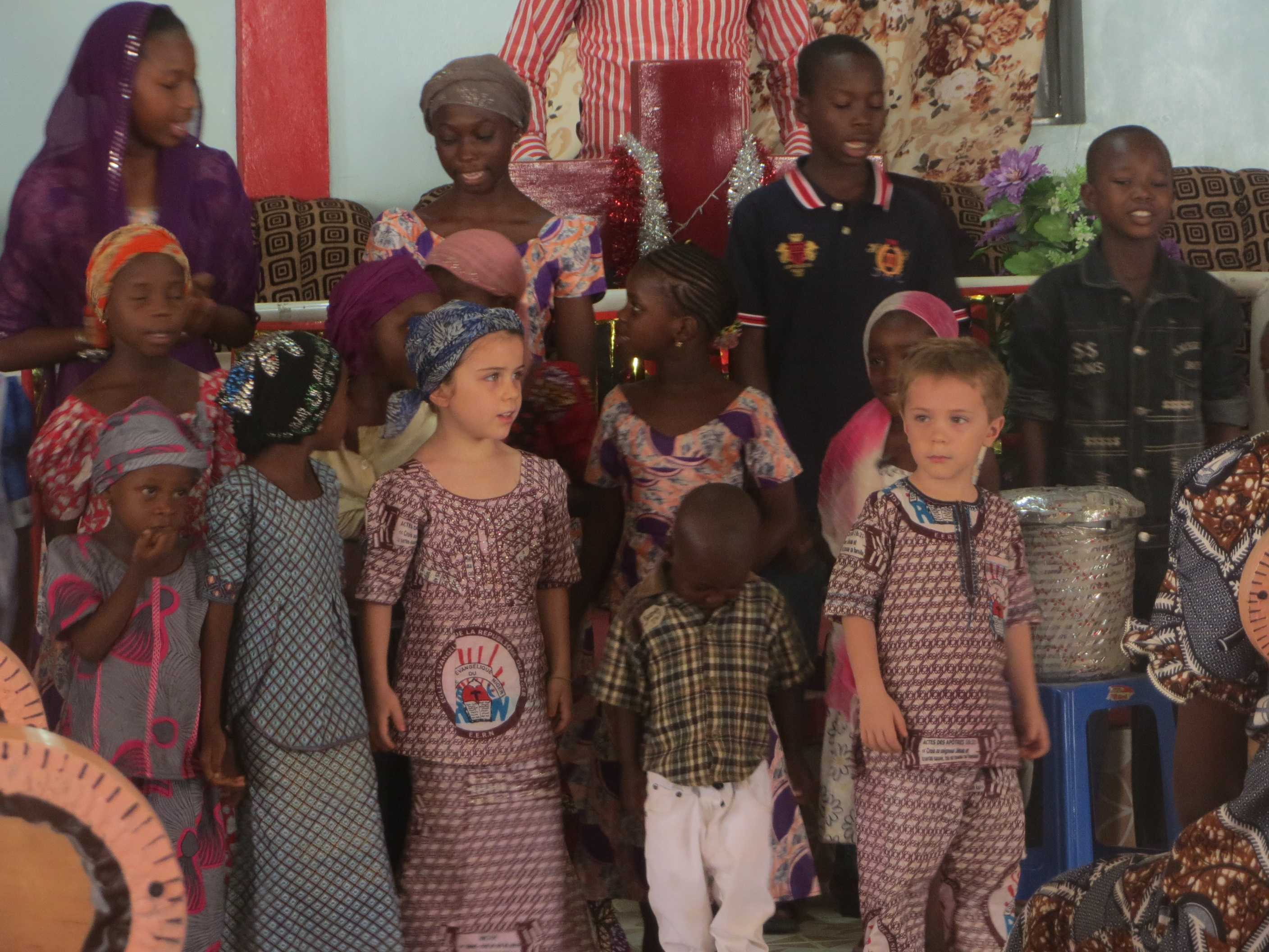 A group of children singing during their time at church.