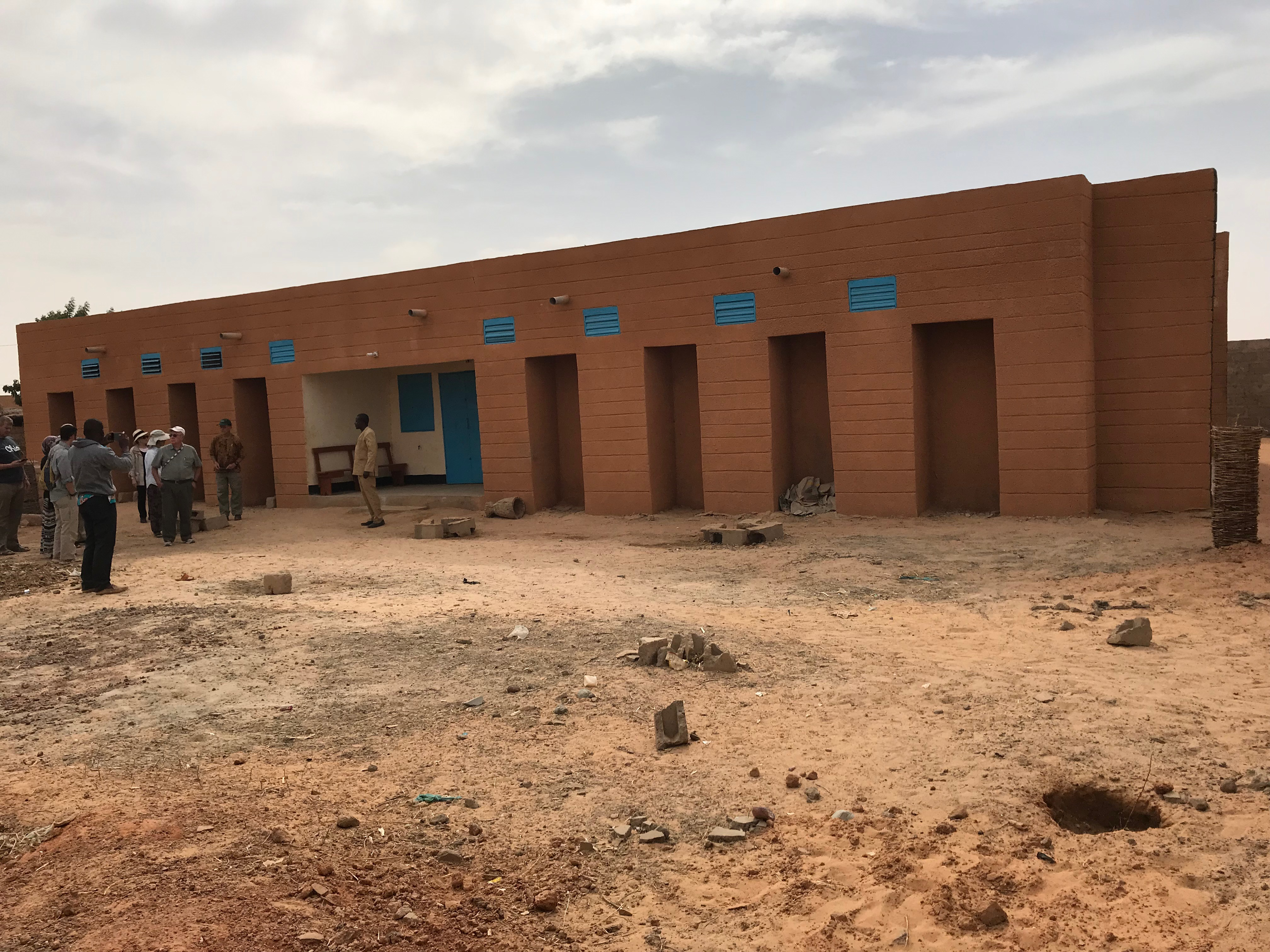 The newly finished student hosting center in this village will hold a maximum 32 students in bunkbeds. There are separate rooms for boys and girls, with a study room in the middle.