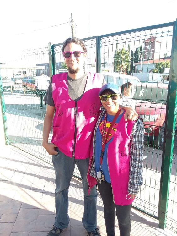 Febe Maldonado and Mike Montoya, volunteers of the Migrant Resource Center, accompany families seeking asylum from the Center to the Port of Entry.