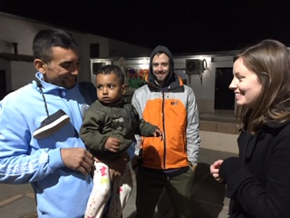 An unlikely encounter at CAME — Pastor Mary Sellers Shaw and Harding from FPC Franklin talking with a father with his son from Honduras.
