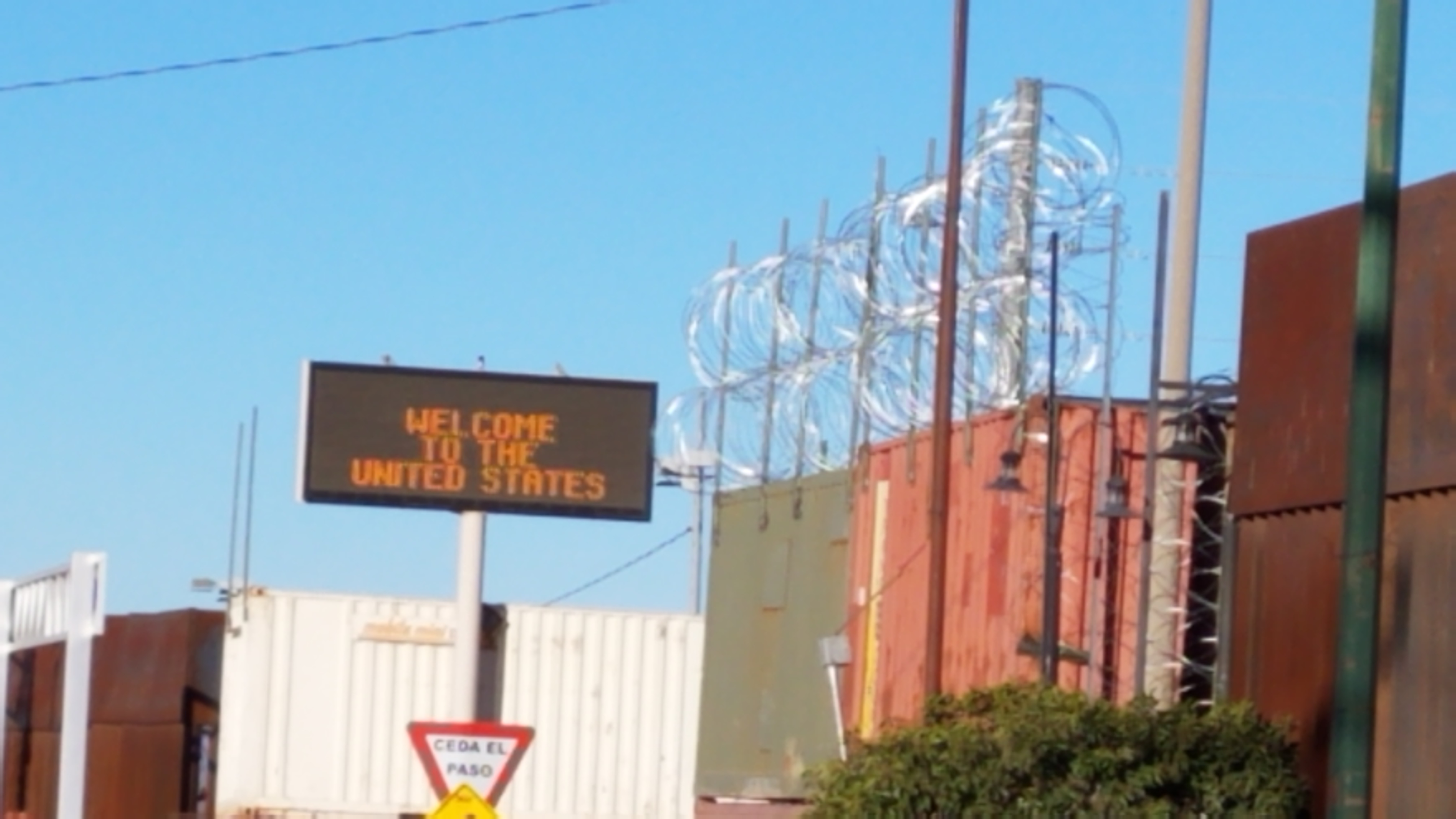 """""""Welcome to the United States"""": the Douglas Port of Entry was fortified with shipping containers and concertina/razor wire in response to the families fleeing violence and extreme poverty in Central America."""