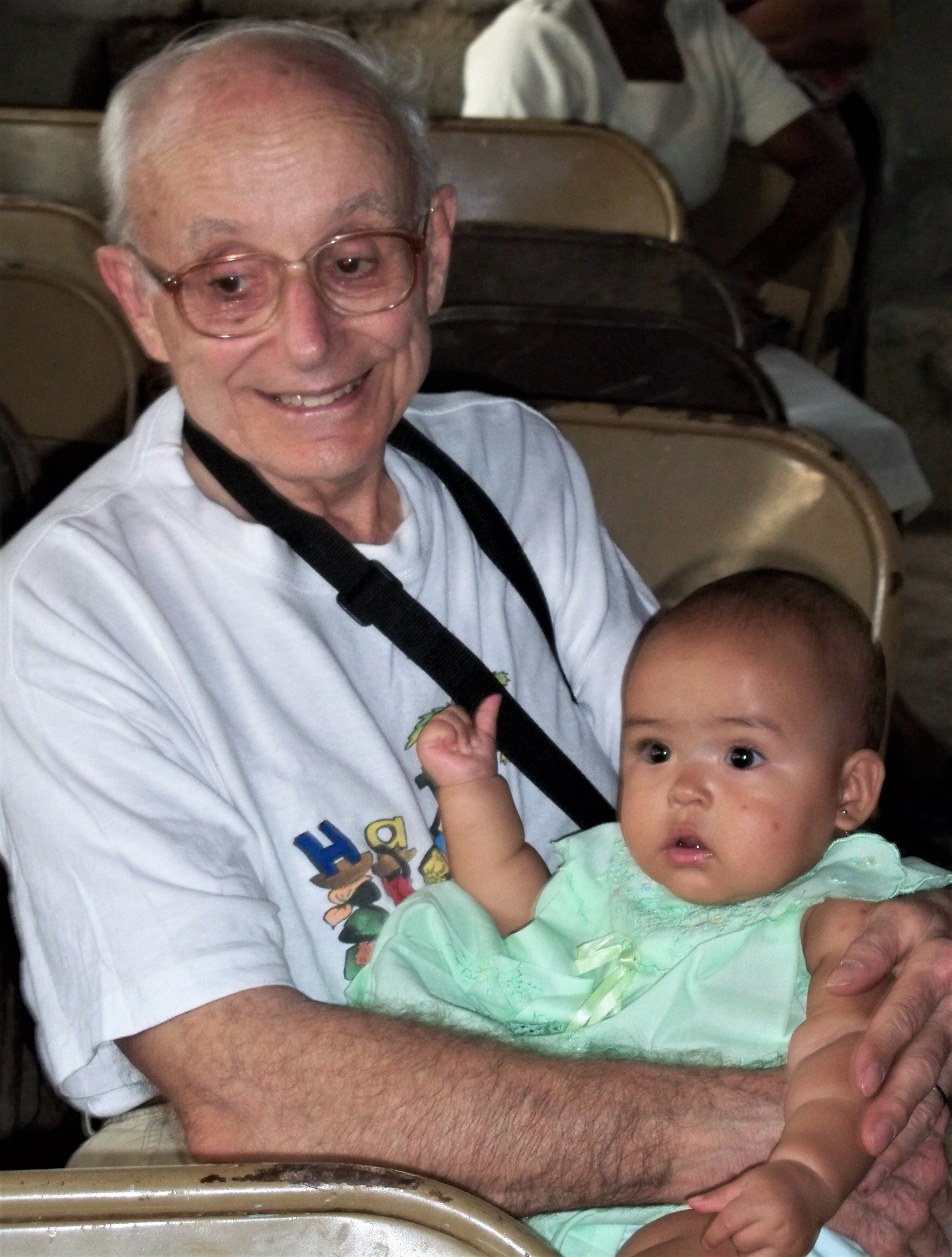 Dad holding Keila in December 2009 when Mom and Dad visited us in Haiti.