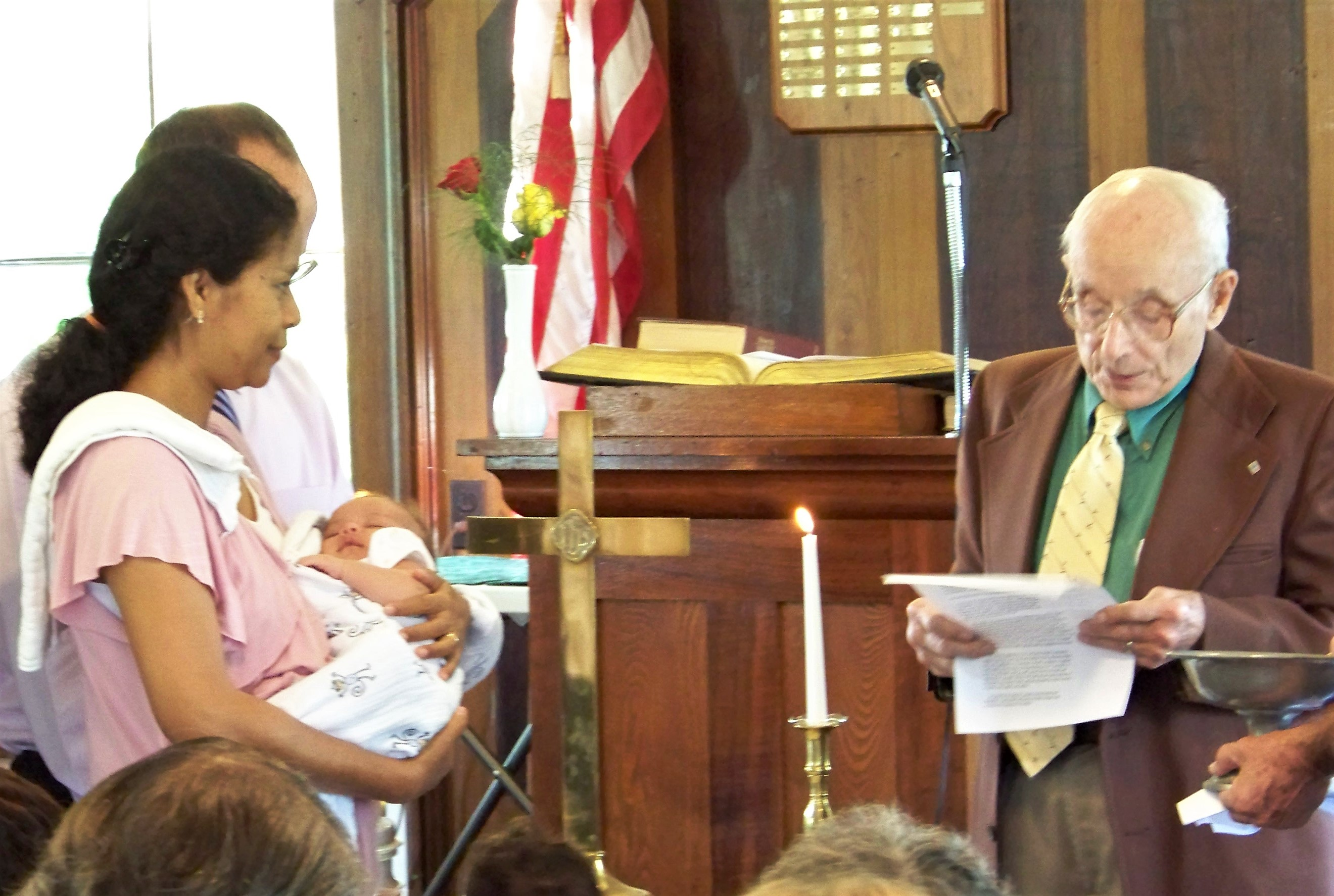 Dad baptizing Annika in September 2011 at the New England Presbyterian Church, a small rural church near Mom and Dad's home in Amesville, Ohio.