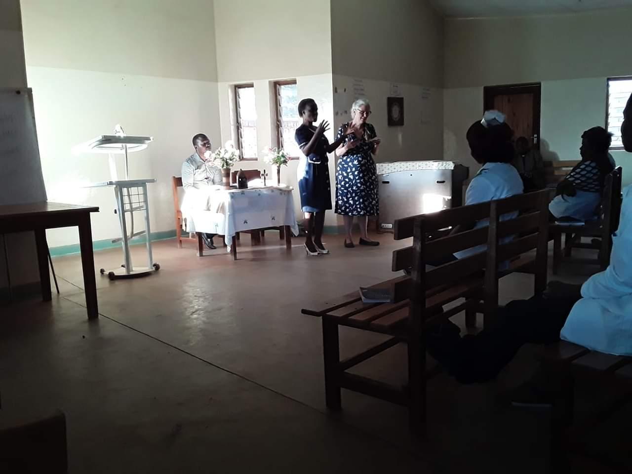 Preaching at Embangweni Hospital Chapel, with George Shaba presiding and Gladys Zimba interpreting. Photo by Wadana Mkandawire