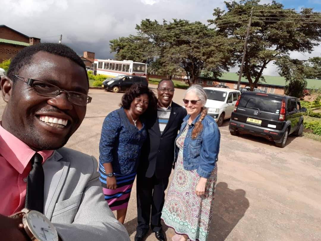 Medical Director Dr. Khondwani Zgambo takes a selfie with Mphatso Nguluwe, Synod of Livingstonia health coordinator; Reverend Joseph Mwale, former head of the mission station at Embangweni and now deputy general secretary of the Church of Central Africa Presbyterian – Synod of Livingstonia; and me at the Synod Headquarters in Mzuzu.