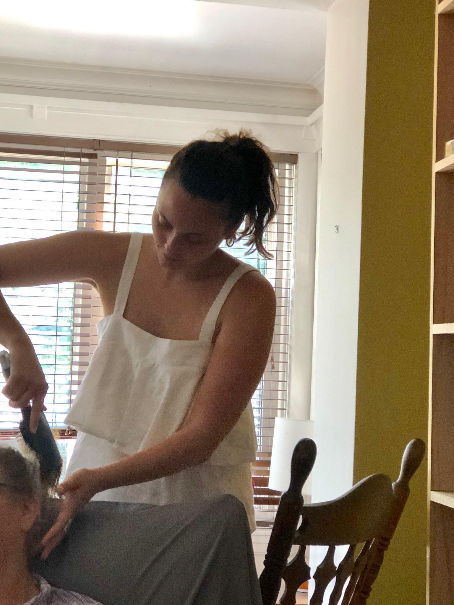 My niece Natalia braiding my hair.