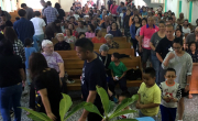 Church members bringing their offerings forward in worship