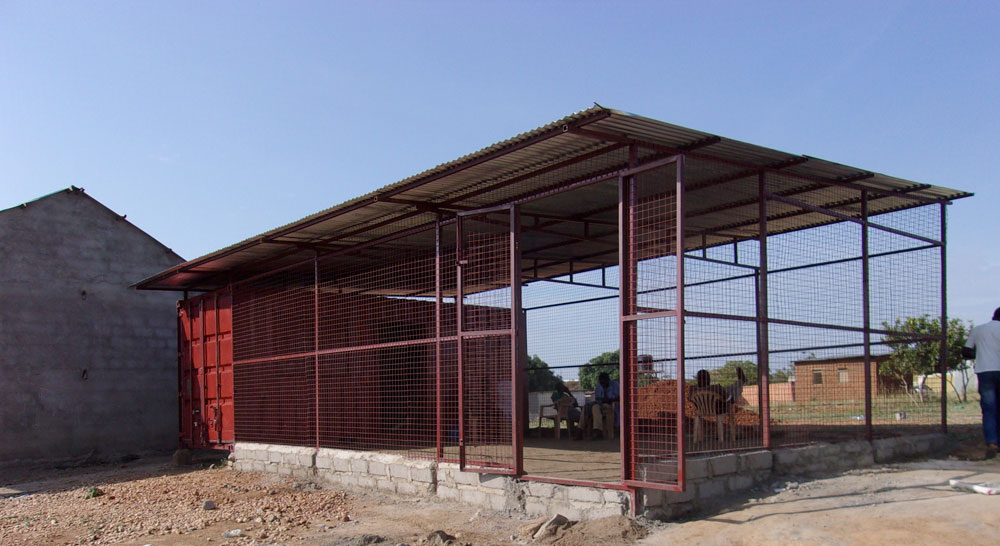 SMART Center in Juba. The shipping container is the red enclosure attached to the caged area.