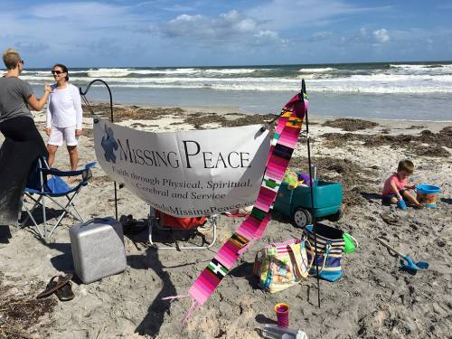 Missing Peace might meet in a park, at the beach or in a primitive church building, all in the same month. Wherever they go, they carry their Missing Peace sign.
