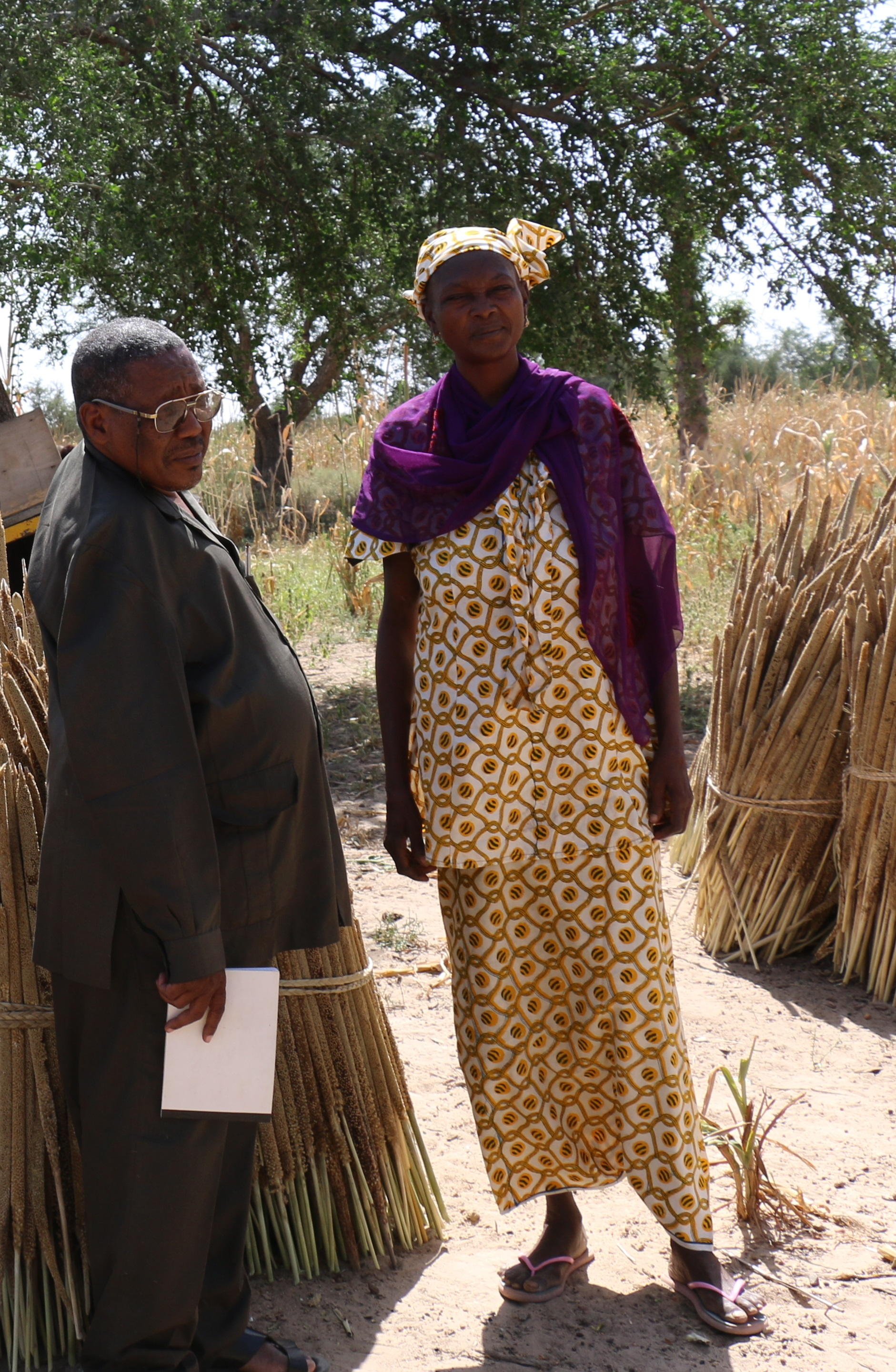 Rebecca standing with another church leader surveying the harvest at the Bible school where she was director.
