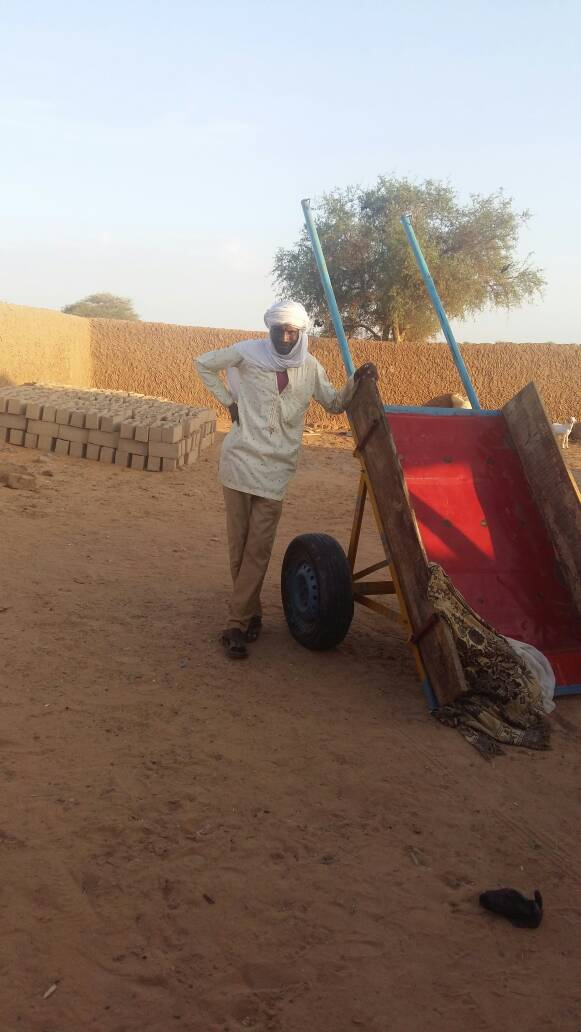 An evangelist from the far northern region receives an ox cart as a gift to help sustain his ministry.