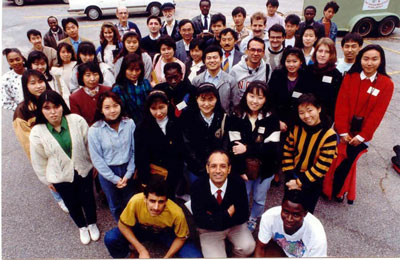The Rev. Fahed AbuAkel, front (center), founded the Atlanta Ministry with International Students (AMIS). For nearly 40 years AMIS has served as a beacon of hospitality and friendship for international and American students in Atlanta. Photo credit: Atlanta Ministry with International Students