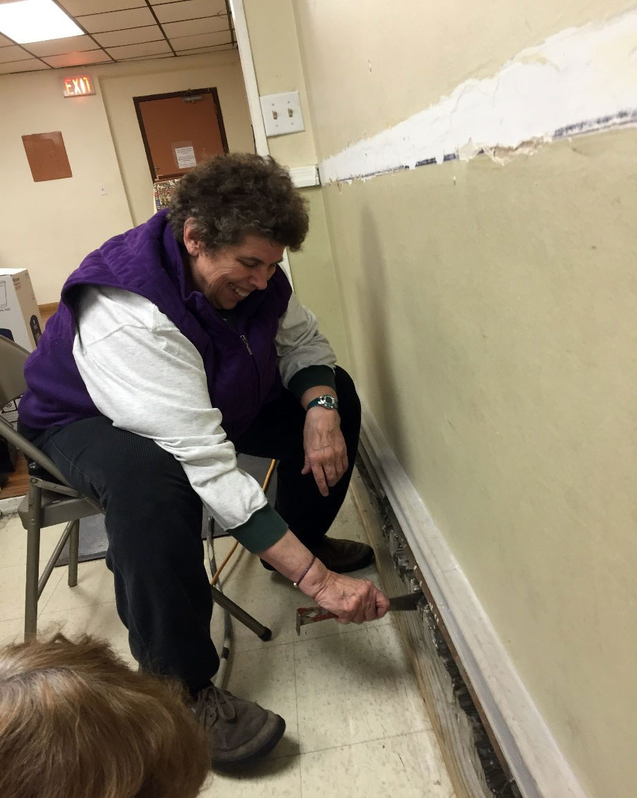 Dr. Rev. Eileen Lindner helping with repairs at the Mideast Evangelical Church in Jersey City, where she serves as Co-Moderator.