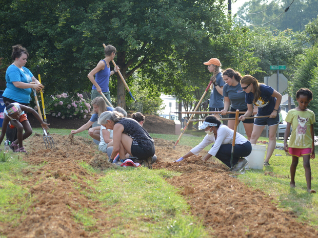 Farm Church participants working the land at one of their four garden spaces. (Photo courtesy of Farm Church)
