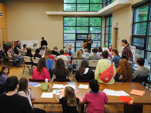 The congregation at Farm Church gathers in a space where windows overlook the gardens. (Photo courtesy of Farm Church)