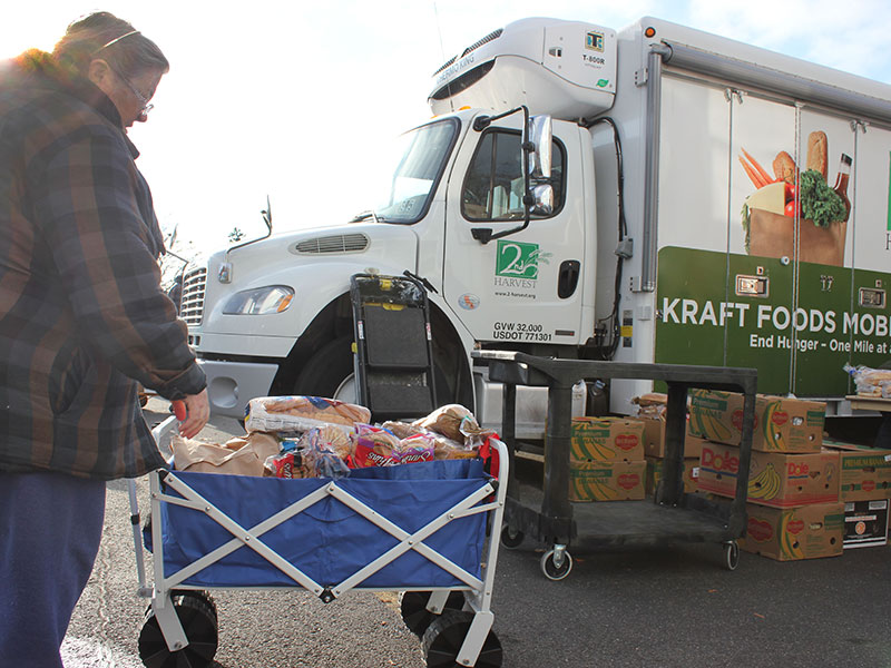 On the second Friday of each month, the Millwood Mobile Food Bank drives up to the church parking lot, where community volunteers help distribute food to neighbors. (Photo by Craig Goodwin)