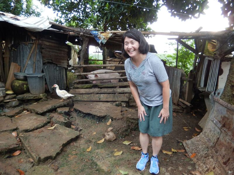 On a recent visit to the southern Philippines with staff from Presbyterian Disaster Assistance, mission co-worker Cathy Chang, regional facilitator for addressing migration and human trafficking in Southeast Asia, enjoys a lighthearted moment with a healthy pig. Photo credit: Laurie Kraus