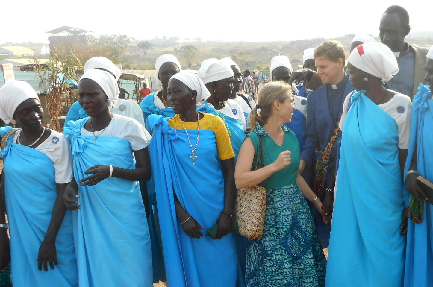 Bob and Kristi Rice are escorted by the Women's Choir of Nuer United Church in an Internally Displaced Persons camp.