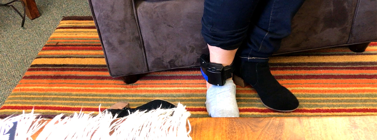 Leonor Garcia shows the ankle bracelet ICE requires her to wear. (Photo by Randy Hobson)