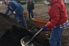Hands & Feet group from the Presbytery of East Iowa assist at Global Farms, where immigrants and refugees learn about agriculture in the Midwest.