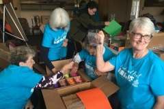 At the Board of Religious Organizations, the service group packed boxes for distribution to children for Christmas.