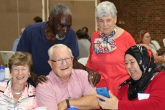 Guilford Park Presbyterian Church members share a moment of laughter with Muslims from the Islamic Center mosque at a covered dish supper after a Ramadan fast on July 2, 2017. (Photo courtesy of Melanie Rodenbough)