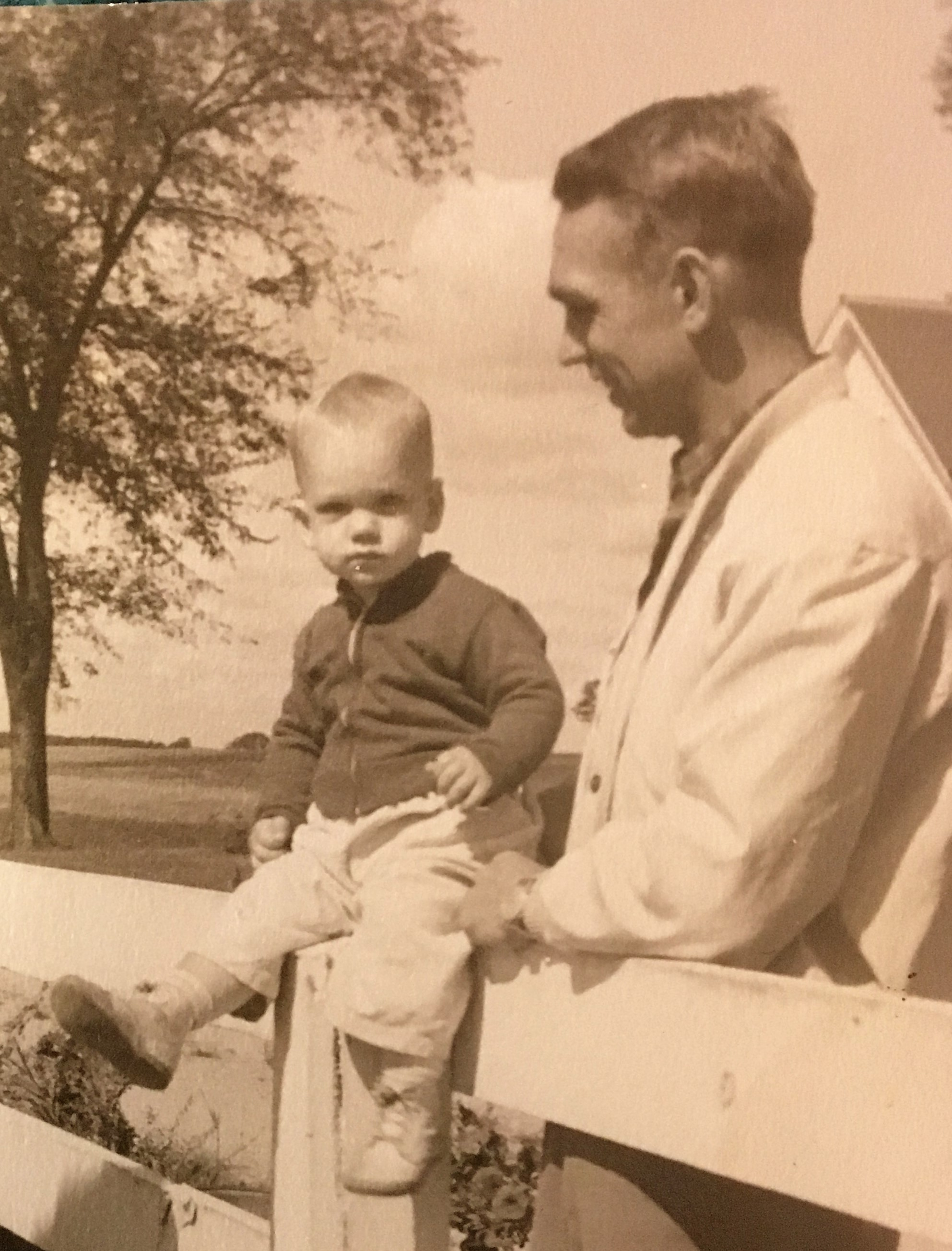 James E. Palm, missionary in the Philippines, with his son and future mission co-worker, Cobbie