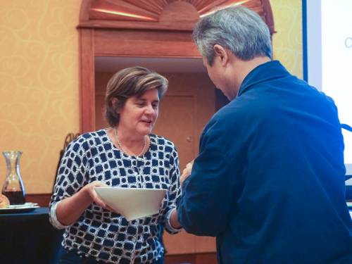 Sharon Stewart, conference planning team member, celebrates communion. (Photo by Emily Enders Odom)