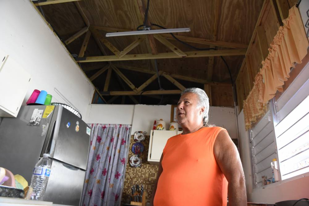 Luis Ramos Salgado at his home in the Caño Martín Peña area. A community collective replaced his roof after it was blown away by Hurricane Maria. (Photo by Rich Copley)