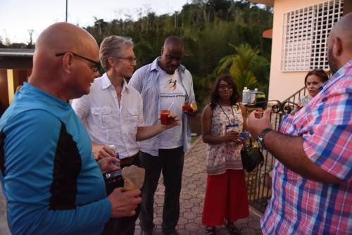 César Oliver (left) and Lourdes Perez (second from right) offered Compassion, Peace & Justice ministry representatives (middle, from left) Andrew Kang Bartlett, Alonzo Johnson, Margaret Mwale and Edwin A. Gonzalez-Castillo (right) a sample of her sweet pepper marmalade. (Photo by Rich Copley)