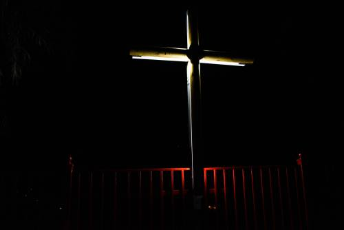 An illuminated cross overlooks Campamento El Guacio in western Puerto Rico. (Photo by Rich Copley)